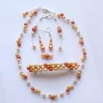 Collier, bracelet, boucles d'oreilles, barette ivoire jaune orange et corail